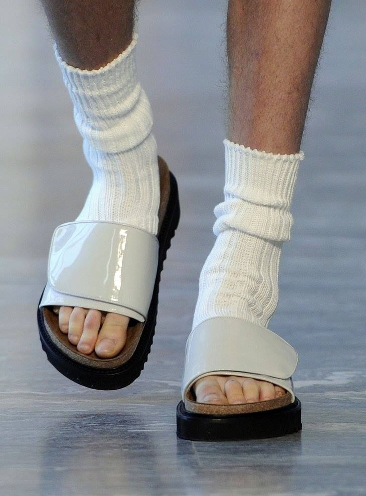 Man wears velcro shoes to work.