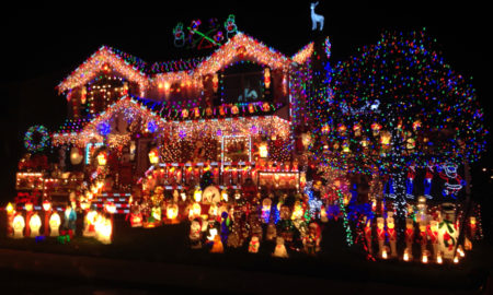 Christmas lights are strung on a house.