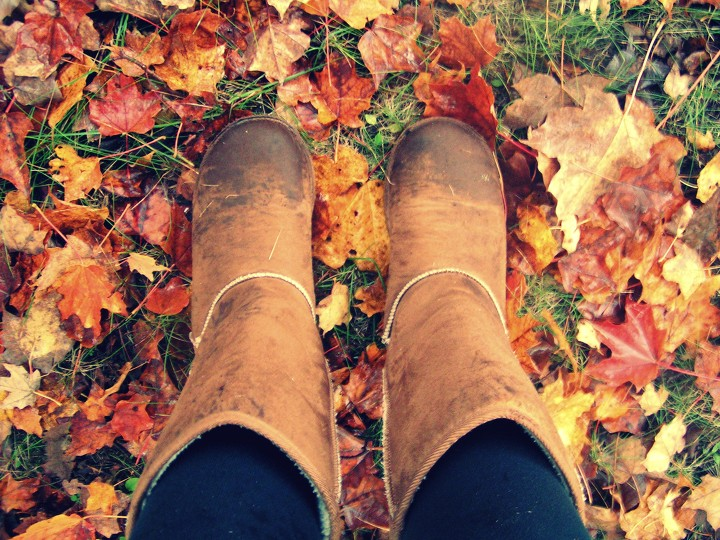 Basic white girl takes pics of self wearing ugg boots over dead leaves for IG, but still wants to be edgy.