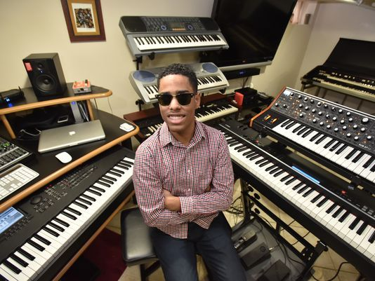 Blind piano prodigy plays in a studio.