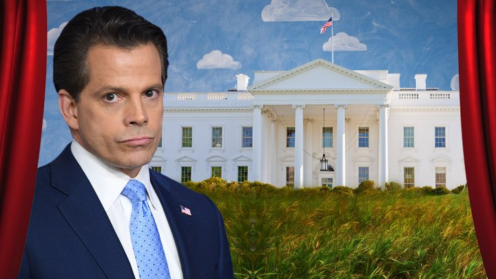 Scaramucci smirks with White House in the background.