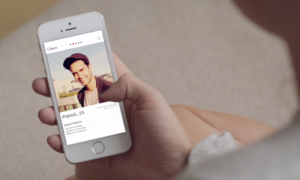 Woman swipes through Tinder to find a suitable person to date.